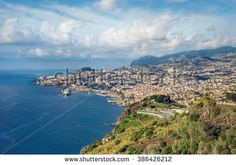 Tropical city of Funchal, Madeira, Portugal with blue ocean, few clouds and major cruise ship. Funchal, Portugal, Cruise, Blues, Tropical, Ocean, Ship, River, Stock Photos