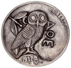 A Hobo Nickel.  This one is interesting because it is a modern version of a silver tetradracham, which is an ancient Greek coin.