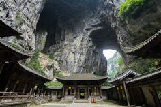 The Wulong Karst (武隆喀斯特) is a karst landscape located within the borders of Wulong County, Chongqing Municipality, People's Republic of China. It is divided into three areas containing the Three Natural Bridges, the Qingkou Tiankeng, and Furong Cave respectively.