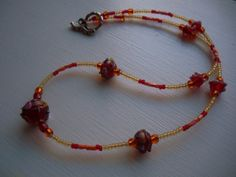Red, Yellow, and Orange Glass Bead Necklace with Decorative Silver Toggle, Beaded