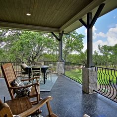 Country Front Porch with Wooden Rocking Chairs