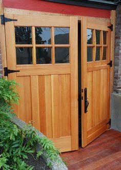 A side hinged wooden #garagedoor - Make your  garage entry more adorable.