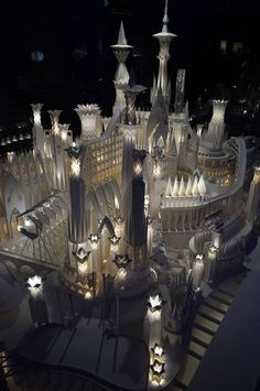 Magical paper craft castle by Wataru Itou. He folds each piece of paper by hand and it took him four years to complete this entire installation, which includes a ferris wheel, electrical lights, and a moving train.
