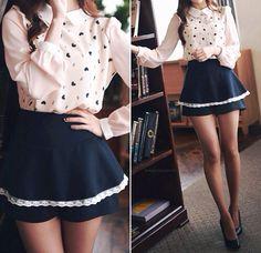 Black short-skirt with a white long sleeved shirt. ^-^