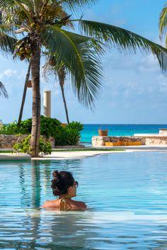 Sitting at the pool at the Viceroy, Riviera Maya