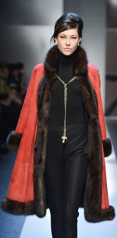 Elegance is the coat thrown across the shoulders then held with the necklace around the coat collar. Yum.