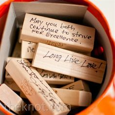 guests sign Jenga blocks so that when the couple plays the game in the future, they can enjoy the notes and well wishes.