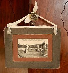 Use an old book cover to create a frame for a vintage postcard -- The Upcycler