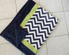 This listing is for a Navy dot and gray chevron minky dot blanket. Soft and snuggly and very durable. It is made with gray chevron with gray minky dot trim. Different sizes available     It is made in a pet free, smoke free home.    If you are looking for other colors, please contact us to see if we can make one that works with your bedding