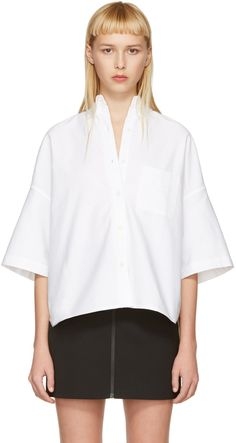Short sleeve cotton shirt in white. Button-down spread collar. Button closure at front. Patch pocket at bust. Tonal stitching.