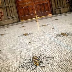 MANCHESTER TOWN HALL BEES: Originally laid out by Venetian craftsmen, the yards of beautiful marble flooring in the building primarily feature cotton flowers along its length. But here, 67 bees are laid out in an overhead design. Manchester Town Hall, Manchester England, Buzzy Bee, I Love Bees, Bee Art, Bee Design, Bee Theme, Save The Bees, Bee Happy