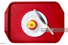 Stock Photo : Directly Above Shot Of Apple In Plate On Tray Over White Background Still Image, Royalty Free Images, Law, Shots, Military, Plates, Apple, Stock Photos, Licence Plates