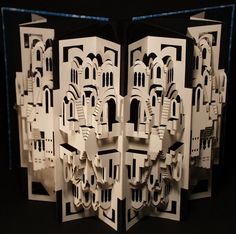 """""""Silent Change"""" - 3-D cut paper art in a folder by Ingrid Siliakus;  interaction between the layers is visible when the folder is opened or closed;  22 x 16 x 16"""