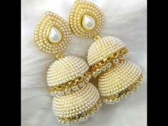 Check out this post - on jhumkas created by Simranjeet Kaur and top similar posts on jhumkas, trendy products and pictures by celebrities and other users on Roposo. Silk Thread Earrings Designs, Silk Thread Bangles Design, Silk Thread Necklace, Silk Bangles, Jewelry Design Earrings, Thread Jewellery, Beaded Jewelry Patterns, Fabric Jewelry, Beaded Necklace