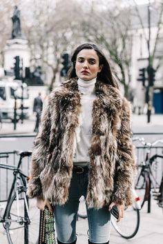 Fur jacket, how to wear a turtleneck, spring transitional outfit ideas, London Fashion Week 2017  Street Style  | via Collage Vintage