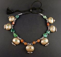 Beautiful old silver tibetan gaus necklace. This composition, of several gau strung together with gemstones is original from Ladakh. The seven