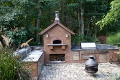 Outdoor kitchen with stucco finish over concrete masonry units.  Full Viking appliance package and Mugnaini pizza oven.