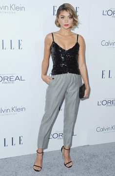 Sarah Hyland wears a black beaded top with gray trousers, a Jimmy Choo clutch and Stuart Weitzman heels.