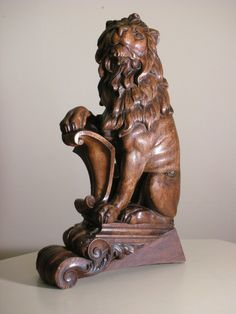 antique carved wood lion  circa  20th century