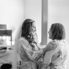 Nothing calms wedding day butterflies like a quick kiss, knowing smile, or reassuring hand squeeze from mom. In honor of Mother's Day, we found the most loving moments captured between the bride, the groom, and their mothers.