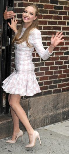 Amanda Seyfried wore a white-and-pink houndstooth-print dress from Balmain with nude Rupert Sanderson pumps