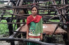 Kamala in front of her menstruation shed.
