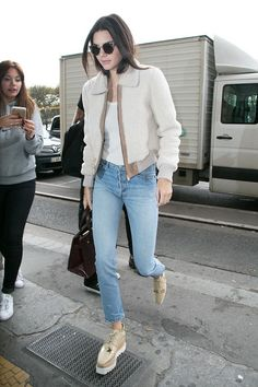Kendall Jenner updates a white tshirt and jeans with platform sneakers and a shearling coat.
