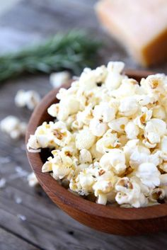 GARLIC ROSEMARY PARMESAN POPCORN -  * 4 tablespoons butter,   * 1 clove garlic, minced,   * 1 teaspoon minced fresh rosemary,   * 3 tablespoons canola oil,   * 1/3 cup popcorn,   * 1/2 cup freshly grated Parmesan cheese,   * Salt, to taste