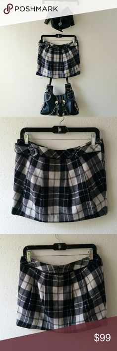 """Plaid Skirt NEVER WORN, NWT. This cute school girl skirt is a must have! It is made of 60% acrylic and 40% wool with polyester lining. It's in pristine condition and ready to move out of my house! Features 2 buttoned down tabs at the top (which can be unbuttoned) and an invisible zipper in the back.  length: 13.5"""" width:18.25  Open to offers! Plastic Island Skirts Mini"""