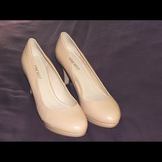 Nine West Nude Platform Pumps Nude.  Leather. Size 7.5. New condition.  Never worn.  Heel height 3.5 inches. Too small.  Purchased $85. Nine West Shoes Heels
