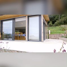 We fitted large Duette® blinds to a glass extension in a B&B in Wales, shading the room while keeping the breathtaking views of the welsh countryside. Zen Home Decor, Glass Extension, Folding Doors, Bed And Breakfast, Countryside, Blinds, Extensions, Middle, Windows