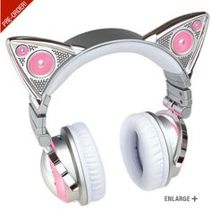 Ariana Grande cat ear headphones, aka What I want for Christmas. with lights, microphone, cat ear speakers. oh and Bluetooth (wireless) available for preorder on brookstone. Will ship out in November!