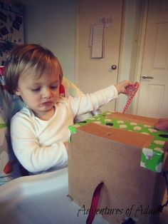 DIY Tug box. Day 93 100 day toddler play challenge. Adventures of Adam. Independent toddler play. The tug box was fairly easy to make. I got a recycled