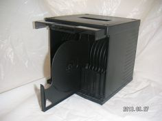 This Black Box holds 36 DISCS, whether it's for your CD-music or DVD/BLURAY-movies.  [MsFrugaLady on eBay, media rack storage organizer]