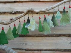 Christmas trees out of vintage woolen blankets, by EEXTERHOUT Felt Christmas Decorations, Felt Christmas Ornaments, Diy Christmas Gifts, Christmas Projects, Felted Wool Crafts, Christmas Sewing, Christmas Makes, Diy Weihnachten, Christmas Inspiration