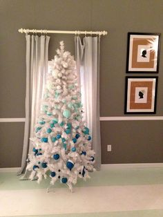 a white Christmas tree with gradient ornaments from white to navy