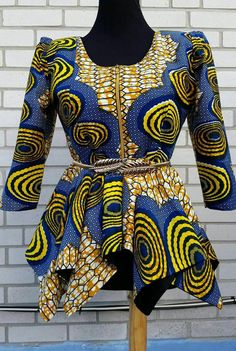 African print blouse u-neck and zipper in front ,peplum top to wear with skirt or skort Blouse is ready to ship Fully linned Belt not included