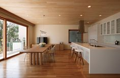 Open concept. White kitchen. Light wood. MUJI VIBE.