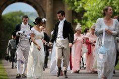 Regency costumed guests arrive for the the Pride and Prejudice Ball at Chatsworth House on June 22, 2013 in Chatsworth, England. To celebrate the 200th anniversary of the publication of Jane Austen's Pride and Prejudice Chatsworth stately home staged a regency costume evening. Chatsworth House is believed to be the inspiration for Pemberley, the residence of Mr. Darcy. Austen based her idea of Pemberley on Chatsworth House as she wrote the novel in nearby Bakewell in 1812. Chatsworth also…