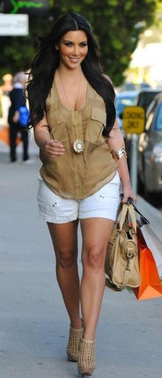 Who made Kim Kardashian's nude pocket tank top, jewelry, nude purse, and nude cage boots that she wore in Los Angeles on July 27, 2010? Shoes – Christian Louboutin  Purse – Balenciaga  Shirt – Madison Marcus Airy pocket  Necklace and bracelets – House of Harlow