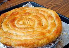 Phyllo Round Feta & Garlic Stuffed Serpent's Coil by ItsJoelen Turkish Recipes, Greek Recipes, Greek Meals, Empanadas, Feta, Phyllo Dough, Greek Cooking, Spinach And Cheese, Goat Cheese