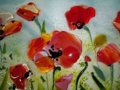 fused glass backsplash | The way that the glass has been layered and melted makes it appear to ...