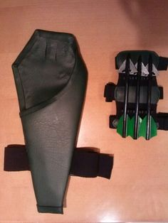 Arrow quivers & What would Green Arrow be without his trick arrows? These are props ...