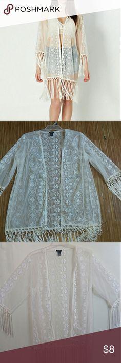 RUE 21 White Kimono Beautiful white see through KIMONO with tassels. Never worn! Size medium Rue 21 Tops