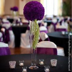 Purple carnation pomander with green hanging ameranthus looks chic against the black linens