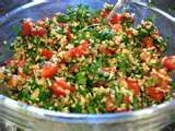 Alicia's Tabouli Salad (large batch)  3 large bunches of parsley--leaves only (chopped very, very fine)  6 large tomatoes or 8-10 roma tomatoes (diced fine)  1 large onion (diced fine) NOTE:  can use green onions or scallions  3 lemons (juiced)  1/2 cup burghal wheat soaked in 1 cup water (squeeze excess after 10 min)  1/2 cup olive oil  Mix all the ingredients together and refrigerate for an hour.  Serve with romaine lettuce (fill romaine leaves with salad and eat like a taco)