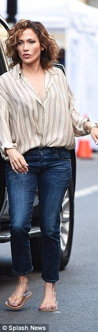 In costume: The thrice-divorced mother-of-two wore beige flip-flops with a striped button-...