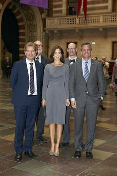 Crown Princess Mary posing with ambassador Rufus Gifford and Lord Mayor, Frank Jensen, at the exhibition.