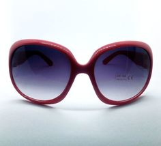Deep salmon pink oval shaped sunglasses featuring UVA/UVB 400 protection for round, oval, long or square faces.