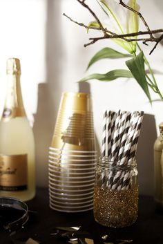 Gold Solo cups and black & white striped straws in a glittered Mason jar are a perfect New Year's color combo.